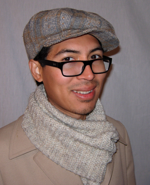 Eric is wearing a plaid wool 1930's News boy cap. He looked fantastic in his hat, cream coat, and beautiful ivory scarf.